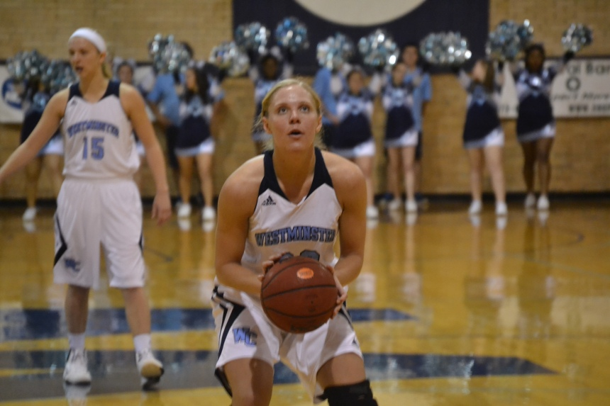 Senior Danielle Smulczenski focuses on the back of the rim for a free throw.  PHOTO BY TIFFANY CRAWFORD.