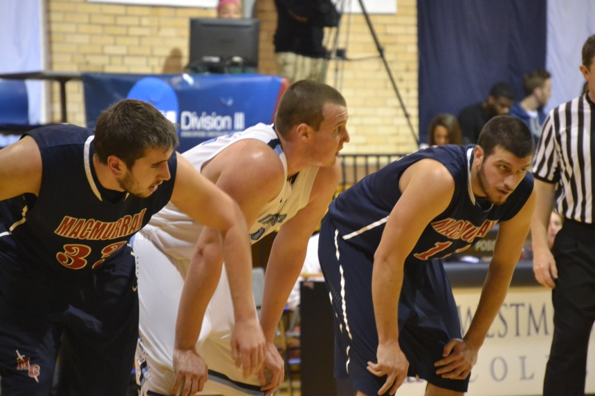 Junior Matt Murphy lines up for a Westminster free throw between two Highlanders.  PHOTO BY EMILY KESEL