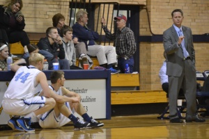 Coach Matt Mitchell gives some last-minute coaching to his substitutes before they enter the game.  PHOTO BY EMILY KESEL