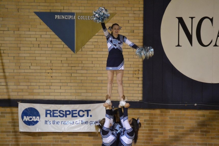 Westminster cheerleaders perform a lift during the men's basketball game. PHOTO BY EMILY KESEL