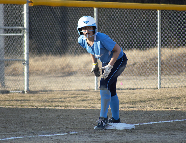 Sophomore Brittany Hodge prepares to lead off from third after a triple against Stephens College.