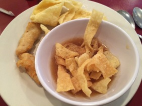 More crab Rangoon, some sweet and sour chicken, and some hot and sour soup with a mountain of wontons piled high on top.