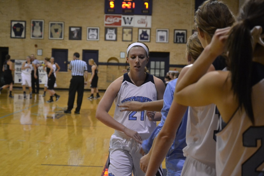 Sophomore Payton Gruber high-fives teammates after coming out of the game. PHOTO BY TIFFANY CRAWFORD