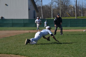 Junior Tyler Branneky makes a diving play on a ball in the infield. PHOTO BY TIFFANY CRAWFORD.