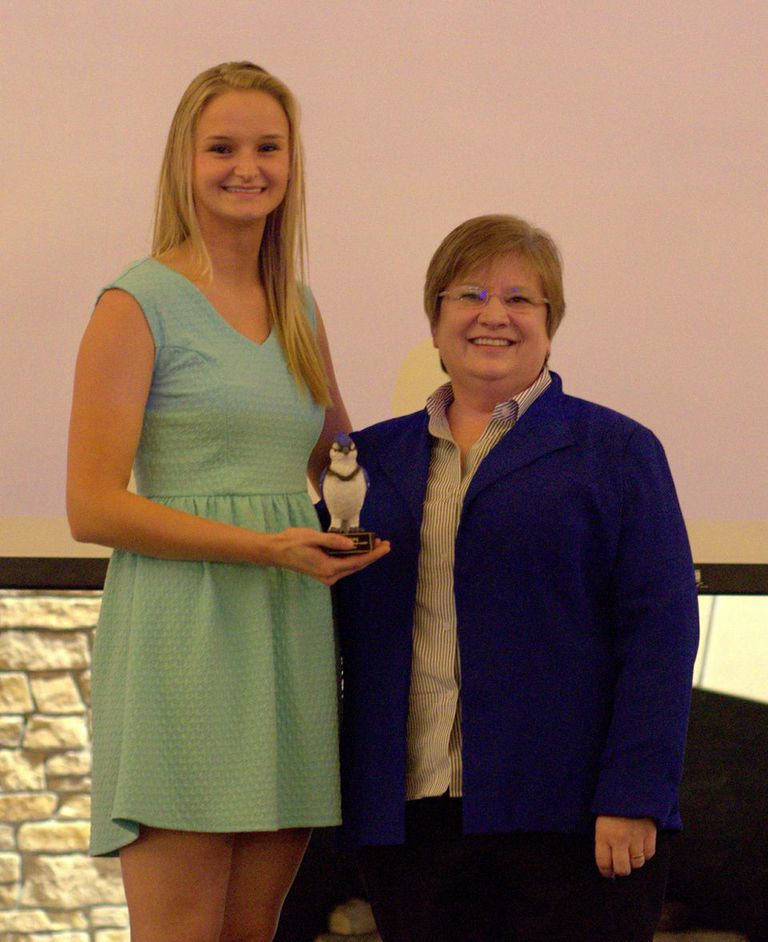 Freshman Karley Long receives the Outstanding Freshman Leadership Award from Dean Krauth at the 2015 Campus Leadership Awards Ceremony. PHOTO BY ABDULLAH AL-HADEETHI.