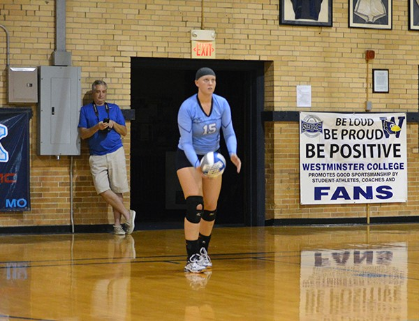 Sophomore Hannah Marshall prepares to serve in a match against Washington University (Mo.) on Tuesday, Oct. 20. PHOTO COURTESY OF WESTMINSTER ATHLETICS.