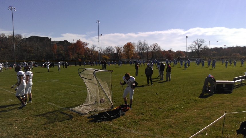 The Blue jays warm up for their last home game of the season. PHOTO BY SAWYER YOUNG.