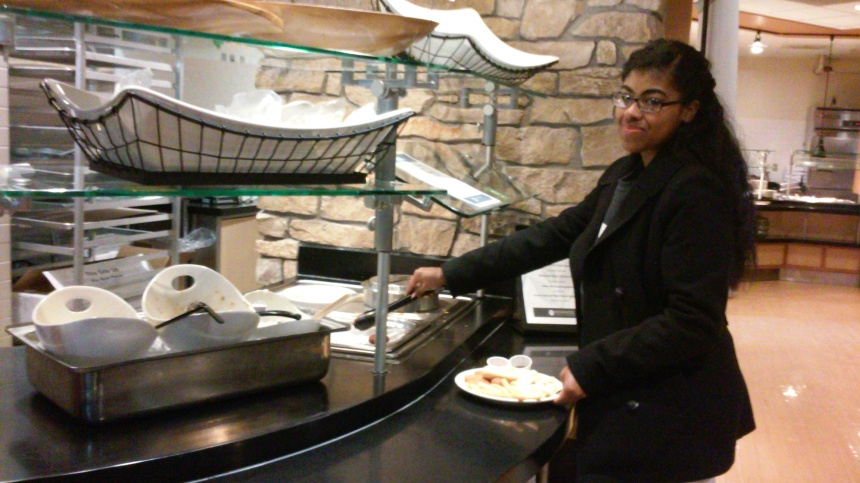 Tychirra Moreno, '19, tries the falafels from Friday's Fresh Fusion station. PHOTO BY STEFANIE EGGLESTON.